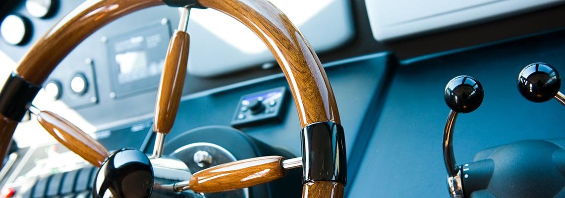 wooden steering wheel on boat